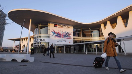A man walks past an entrance of the Mobile World Congress at Barcelona